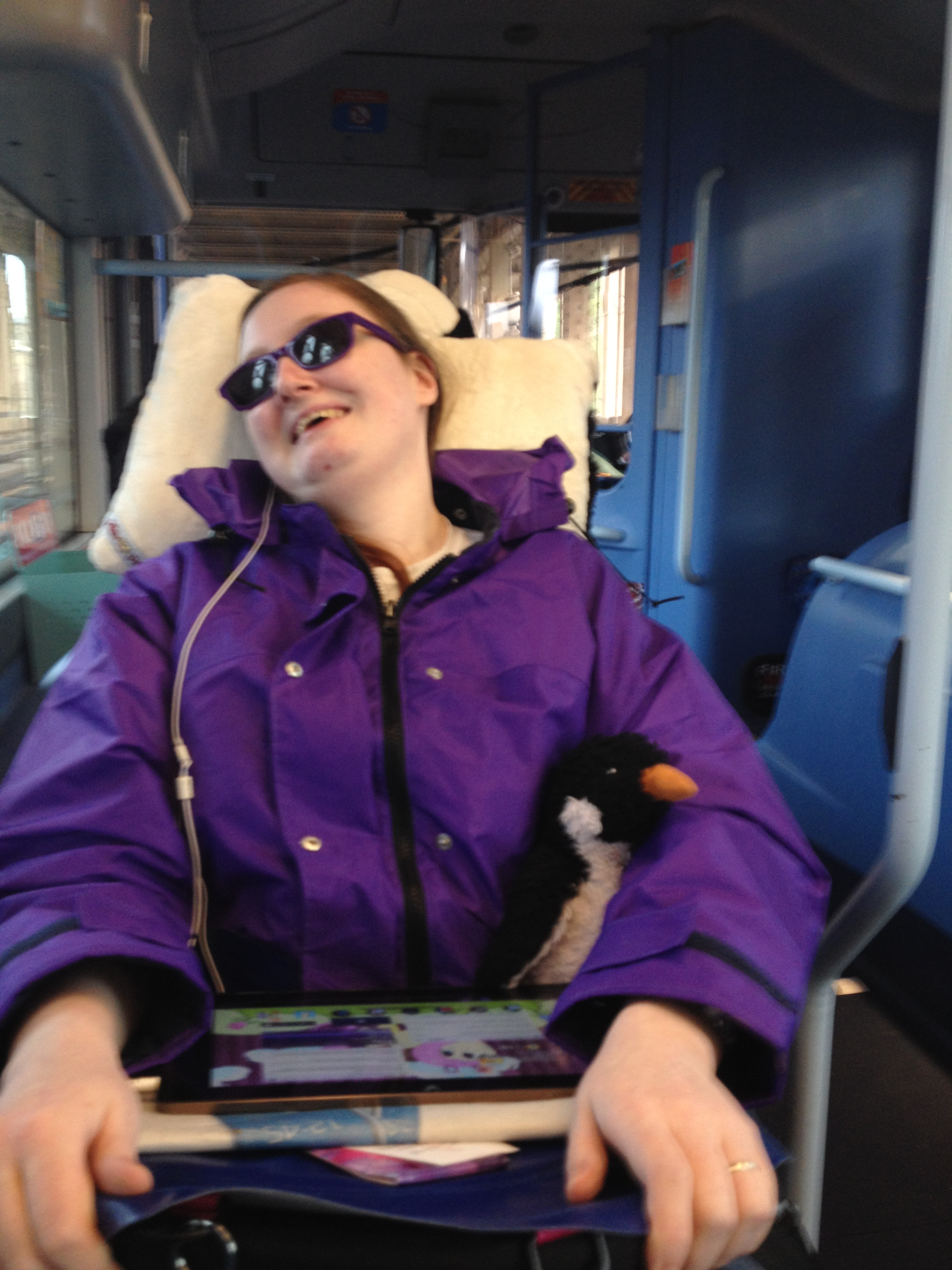 Danni in their new wheelchair on the bus